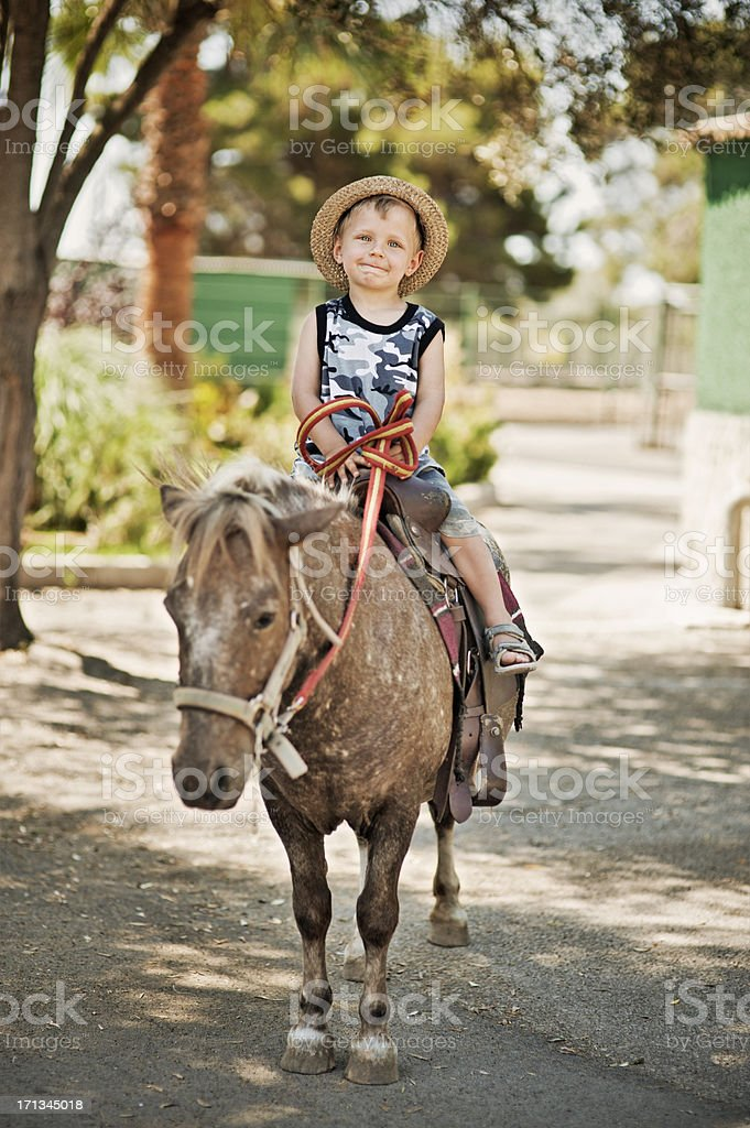 Little boy and his pony stock photo