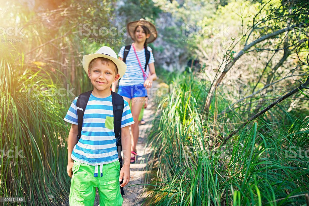Little boy and his sister hiking in Majorca mountains stock photo