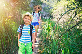Little boy and his sister hiking in Majorca mountains