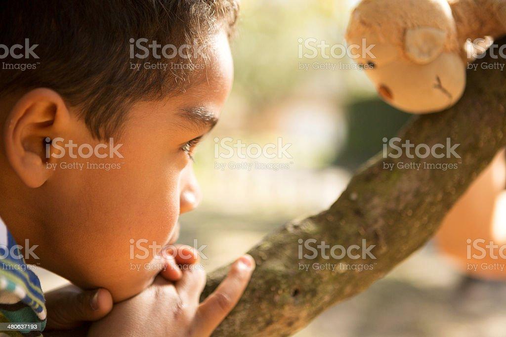 Little boy and his stuffed animal stock photo