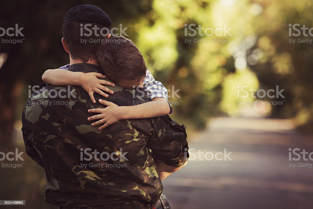 Little boy and soldier in a military uniform stock photo