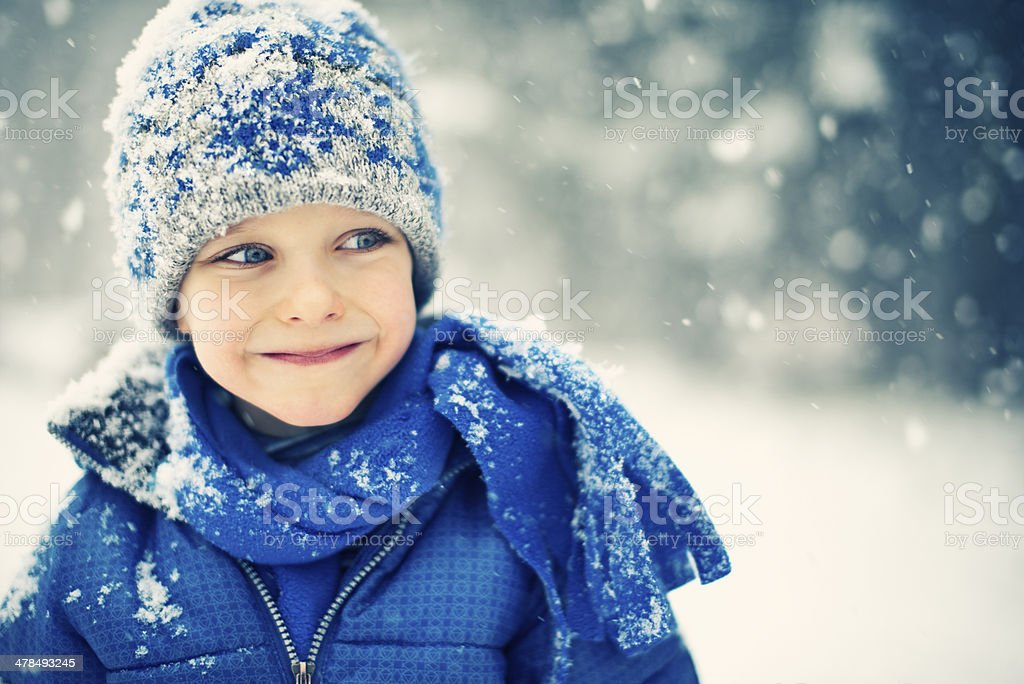 Little boy and the snow stock photo