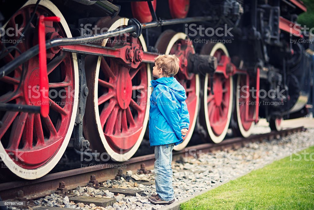 Little boy and the steam locomotive stock photo