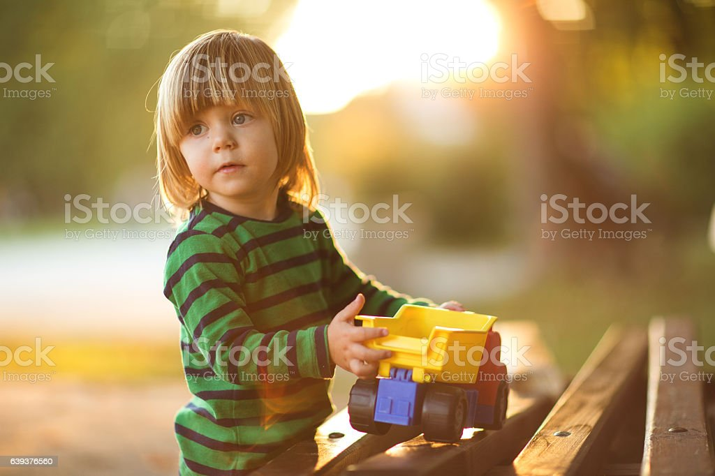 Little boy and toy stock photo