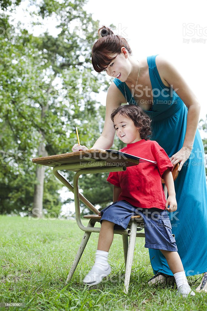 Little Boy and Woman at Desk Outdoors royalty-free stock photo