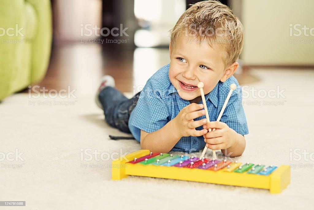 Little boy and xylophone stock photo