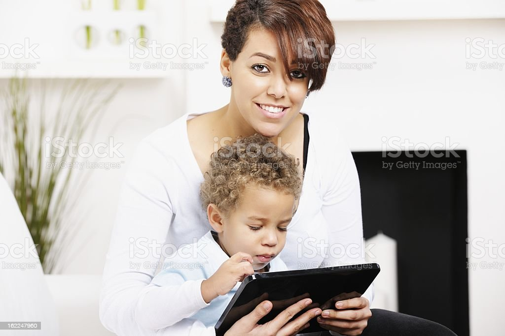 Little Boy And Young Mother/ Sister Using A Digital Tablet stock photo