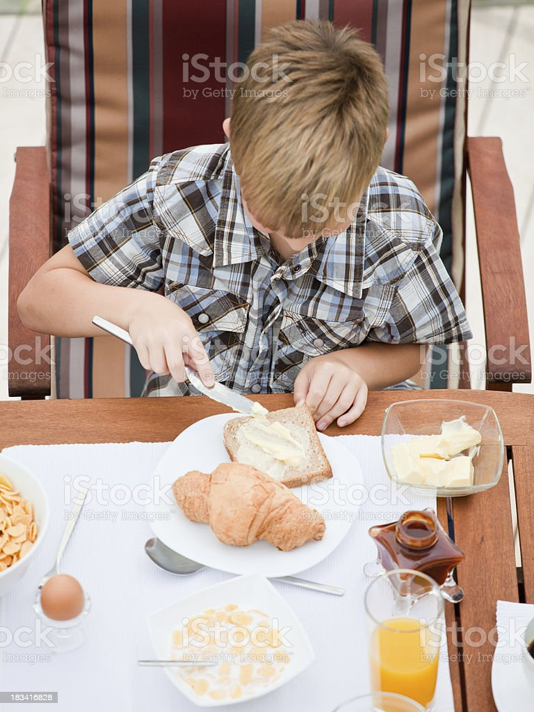 Little boy at breakfast royalty-free stock photo
