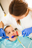 Little boy at dentist's office replacing fillings.