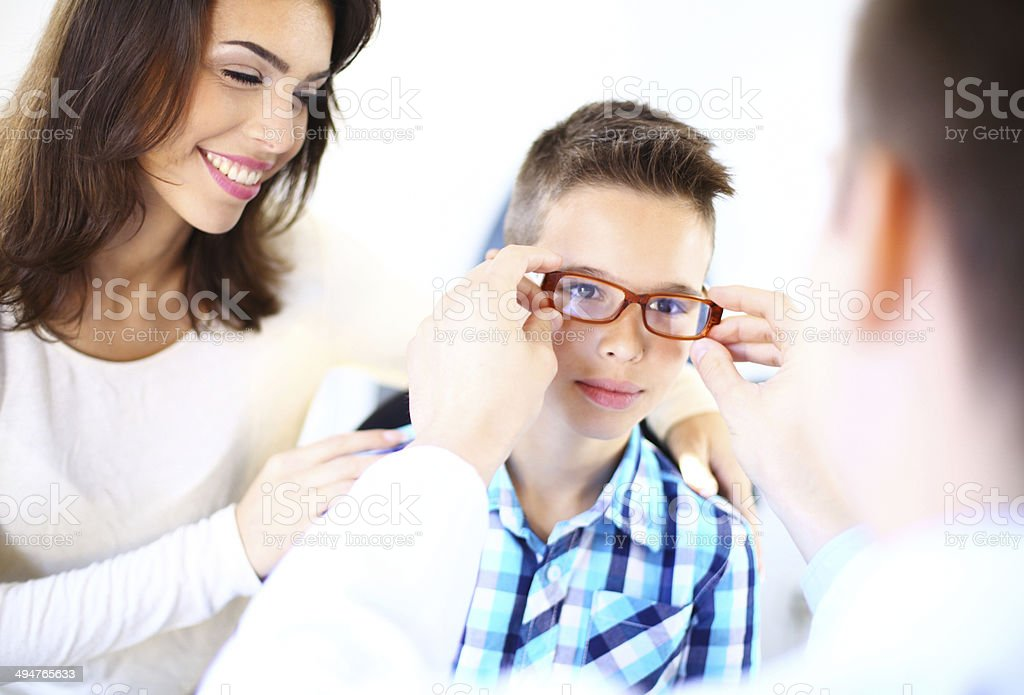 Little boy at optician's office. stock photo