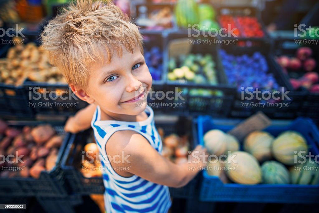 Little boy at the Italian farmer's market stock photo