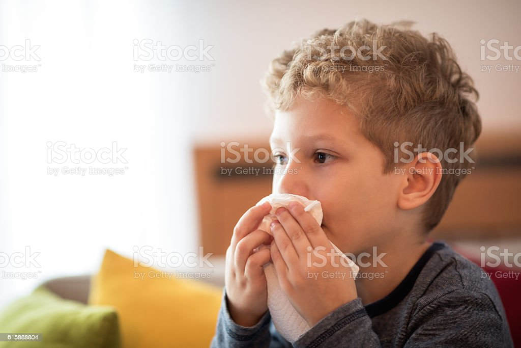 Little boy blowing nose stock photo