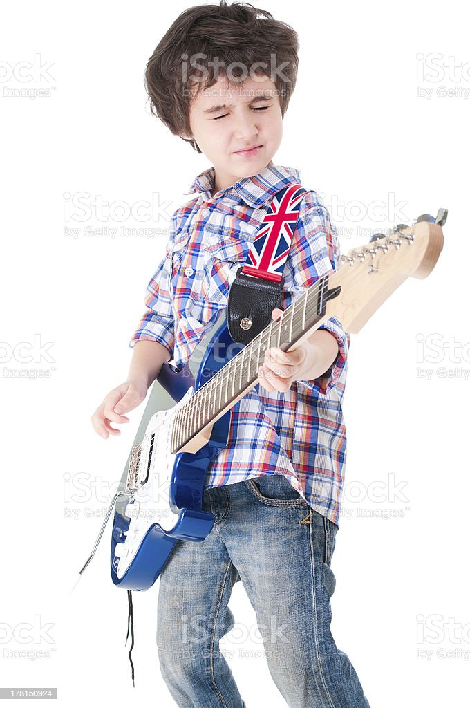 Little boy britpop style with electoguitar eyes closed stock photo