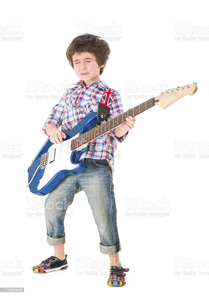 Little boy britpop style with electoguitar full body stock photo