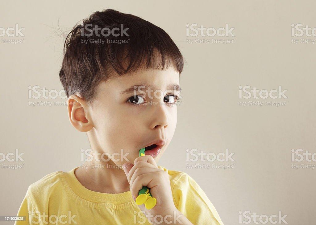 Little boy brushing teeth royalty-free stock photo