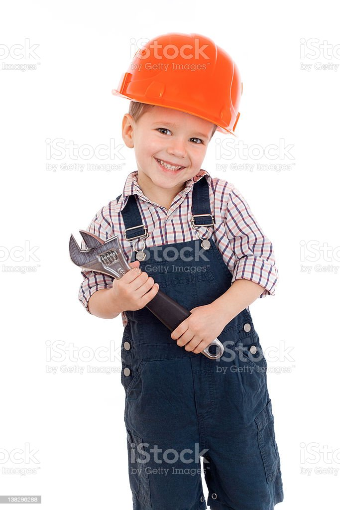 Little boy builder in construction hat with wrench royalty-free stock photo