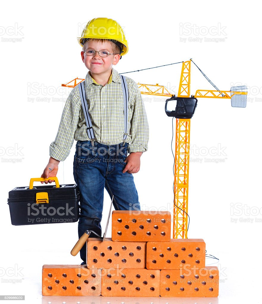 Little boy builder stock photo