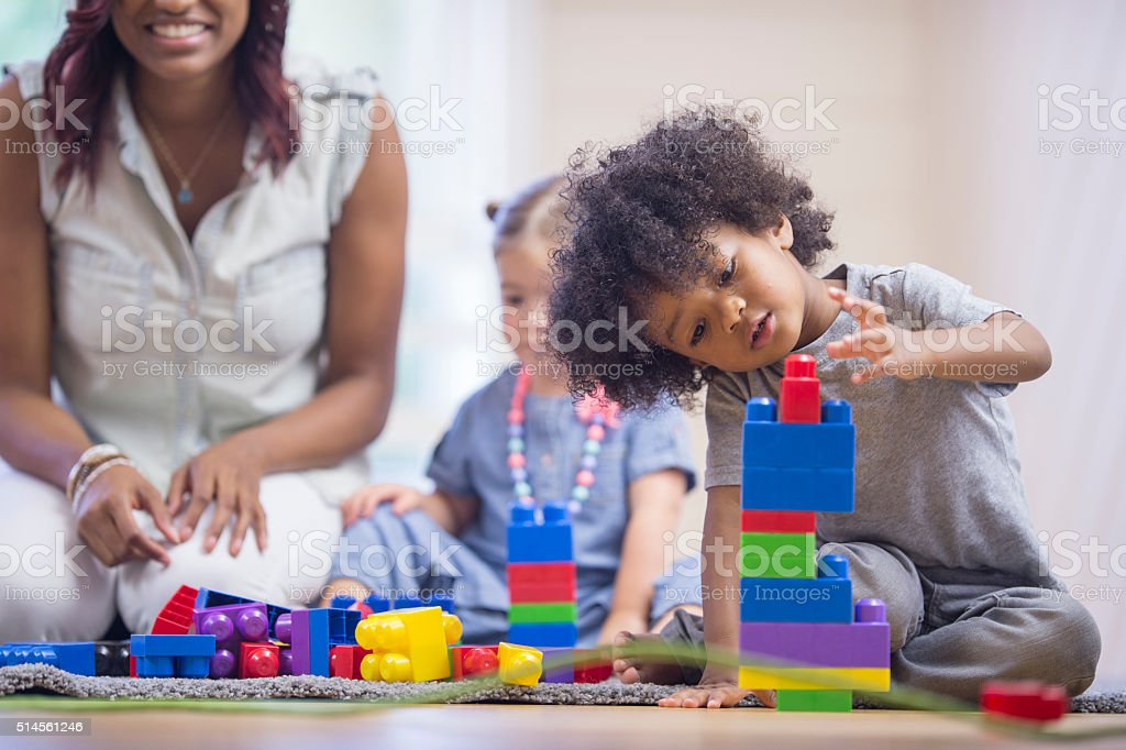 Little Boy Building a Tower stock photo