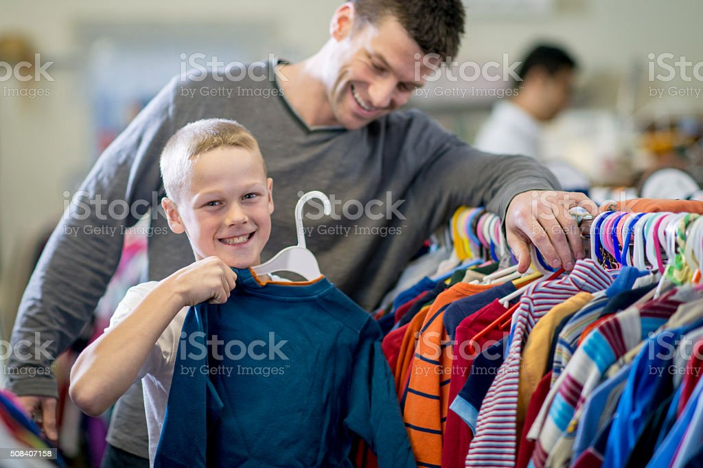 Little Boy Buying a Shirt stock photo