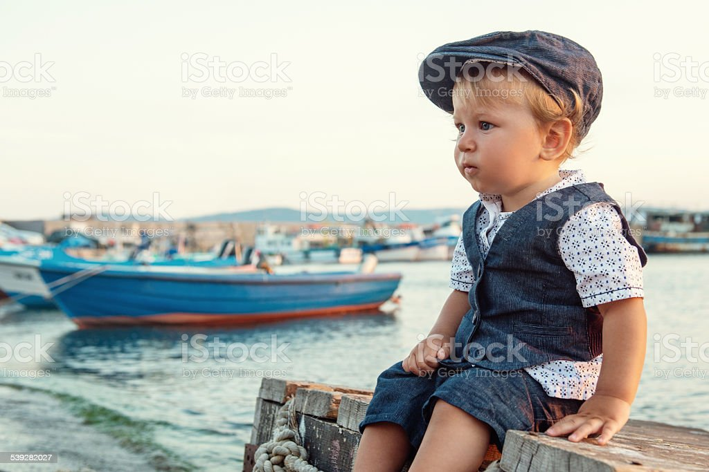 Little boy by the sea stock photo