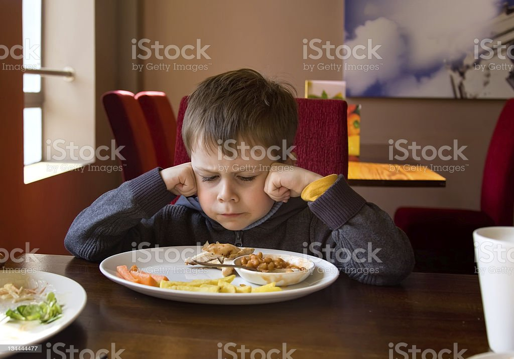 Little boy can't finish his lunch stock photo