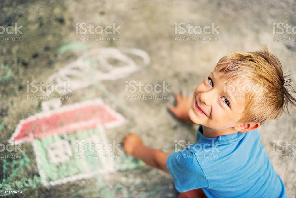 Little boy chalking stock photo