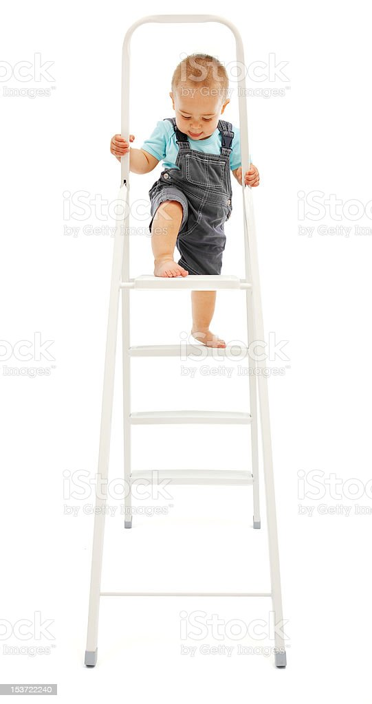 Little boy clambering up on ladder royalty-free stock photo