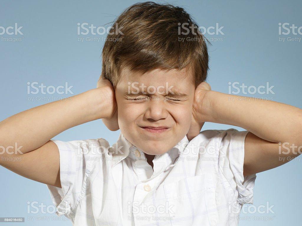 little Boy closing his ears stock photo