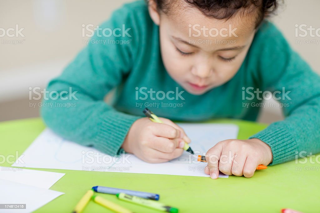 little boy colouring at daycare royalty-free stock photo