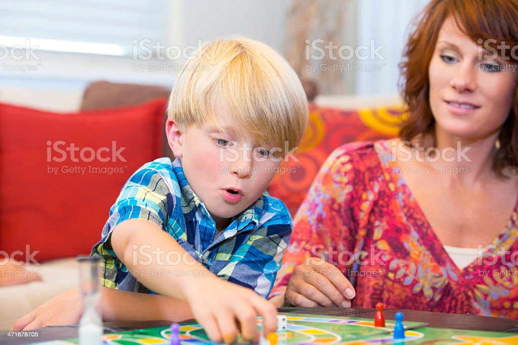 Little boy contemplating his next game move stock photo