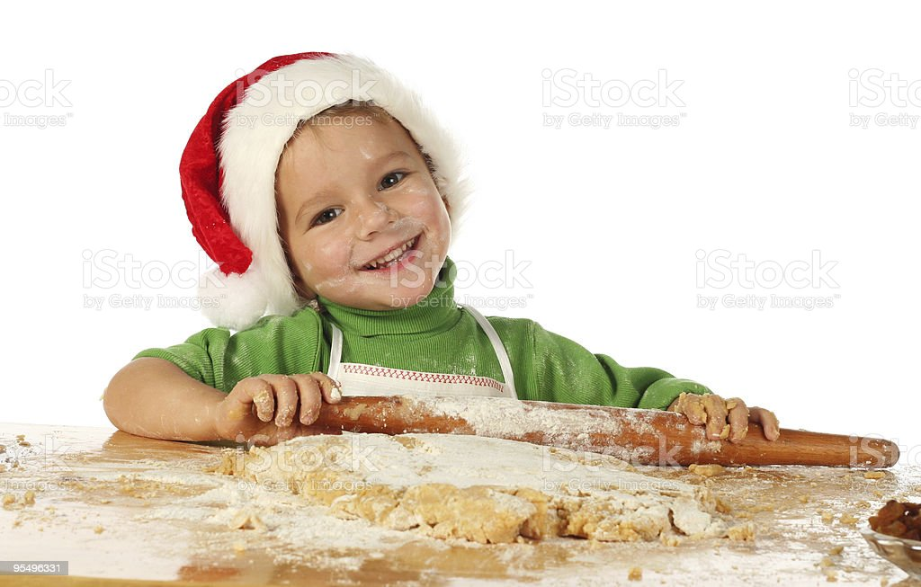Little boy cooking the Christmas cake royalty-free stock photo