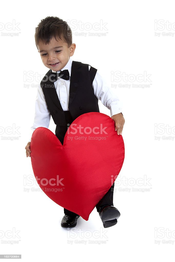 little boy dancing with heart shape stock photo