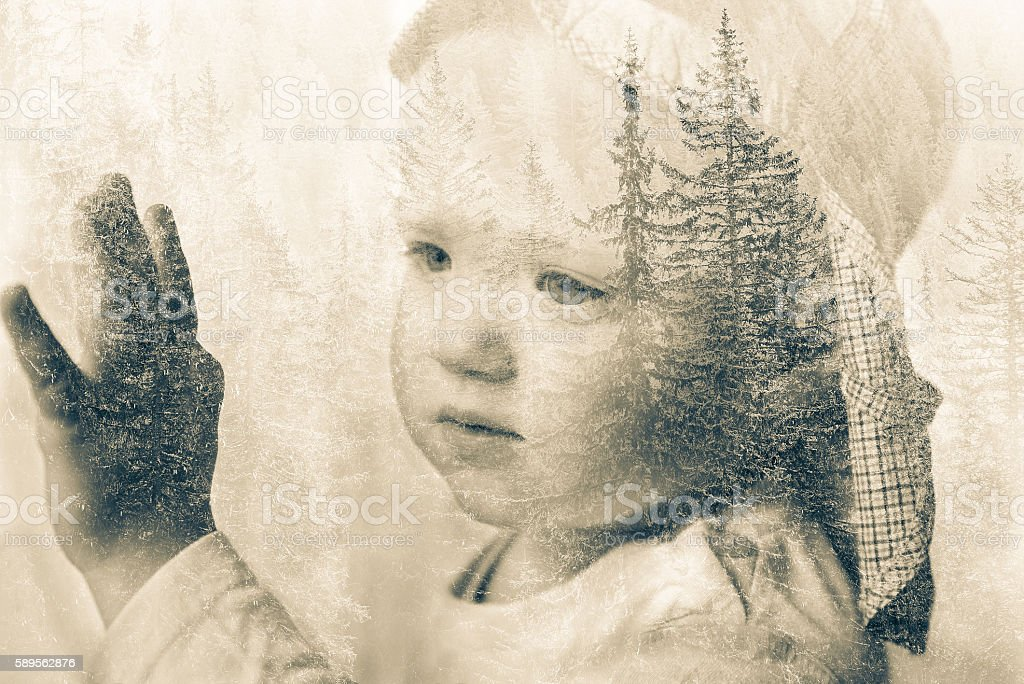 Little boy daydreaming, looking out the window, double exposure stock photo