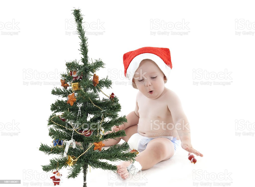 Little Boy Decorating Christmas Tree royalty-free stock photo