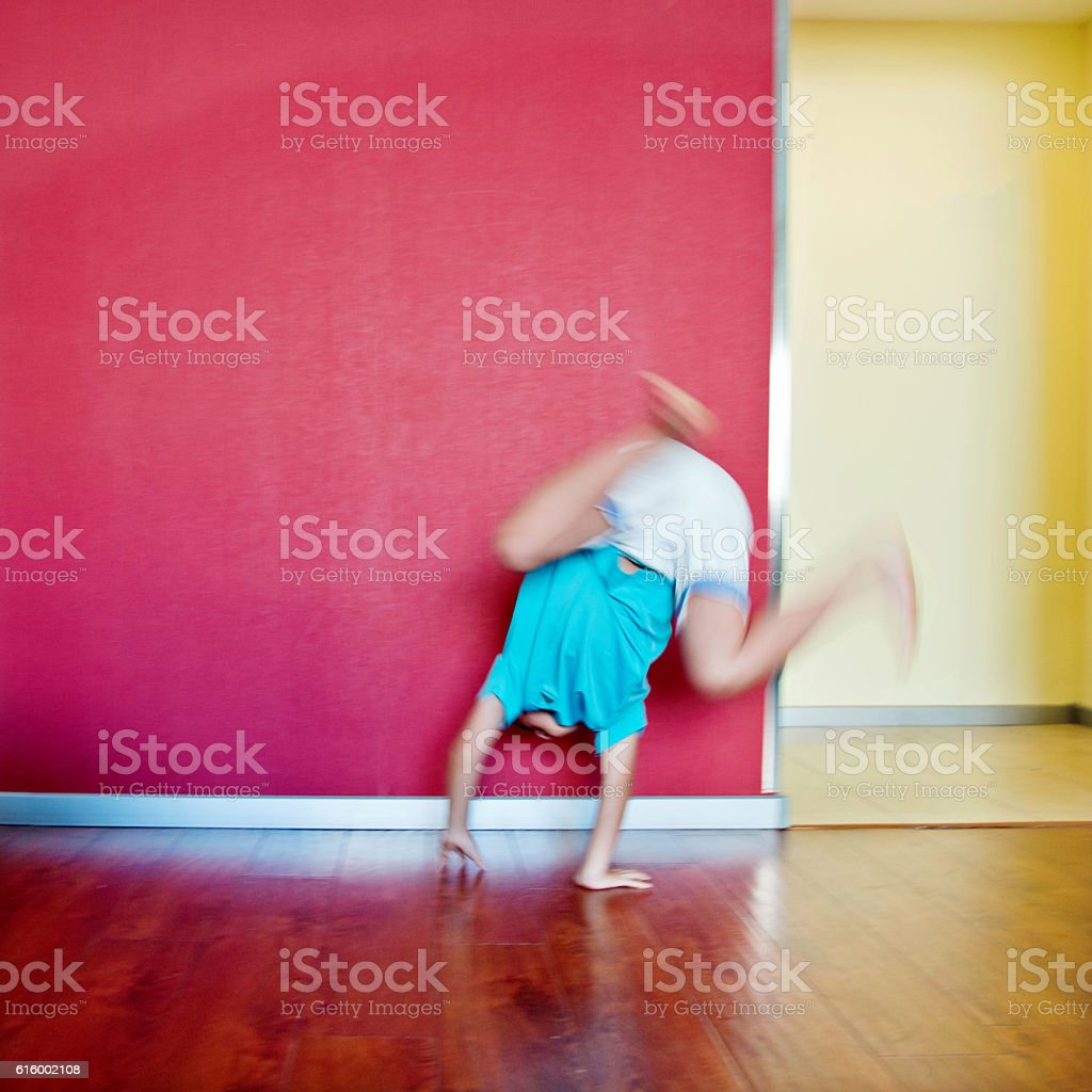 Little boy doing a somersault at home stock photo