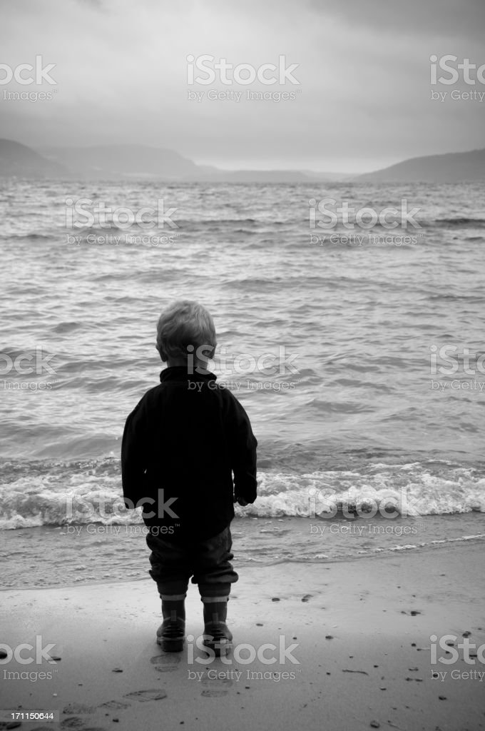 Little boy dreaming at the sea royalty-free stock photo