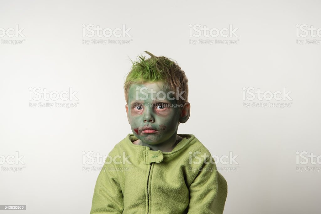 little boy dressed as a zombie on halloween stock photo