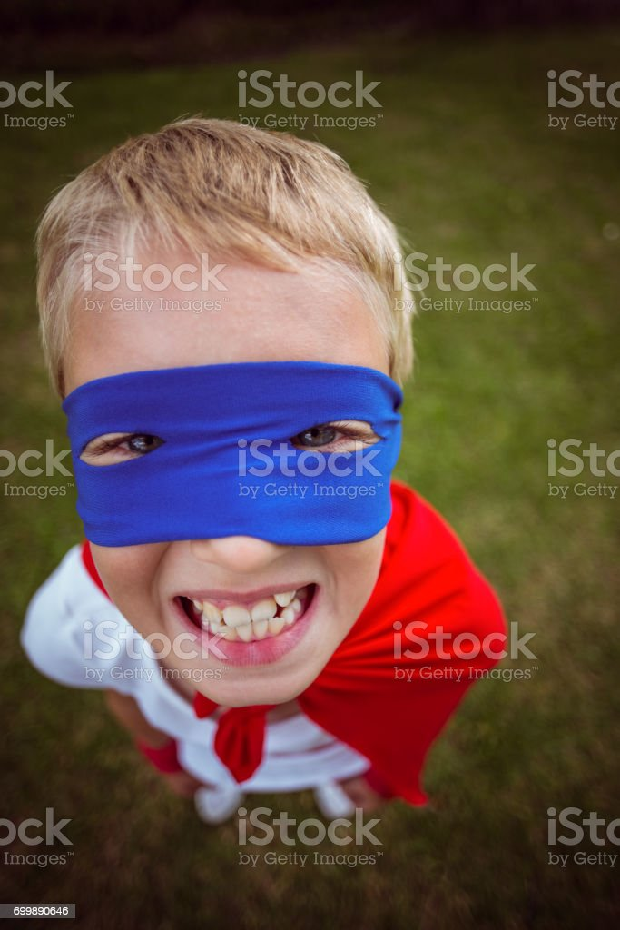 Little boy dressed as superman stock photo