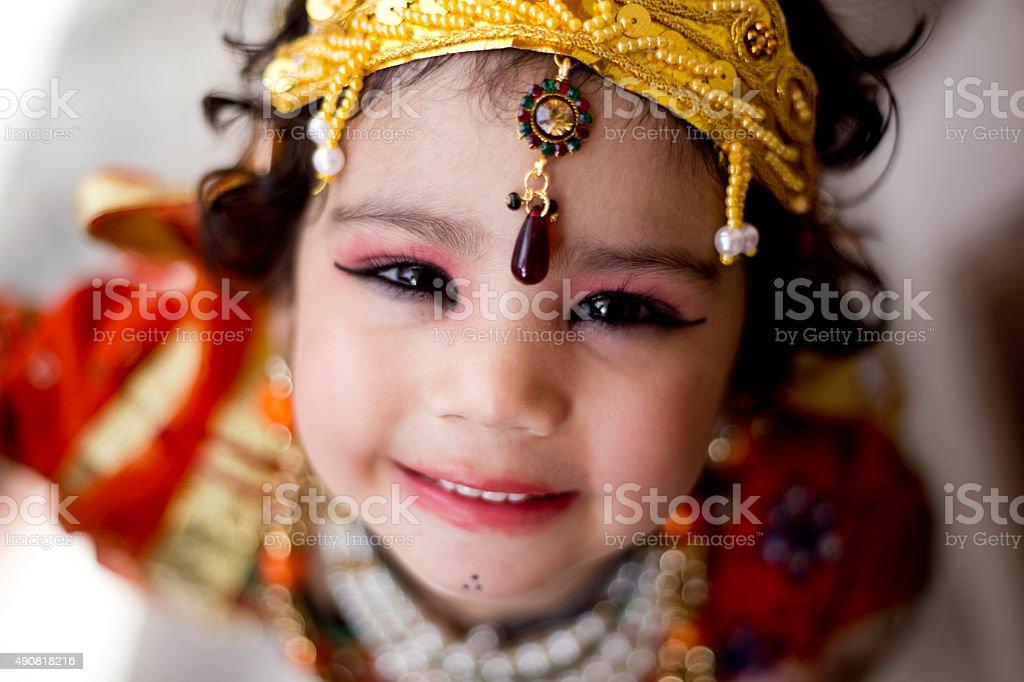 Little boy dressed up as Krishna stock photo