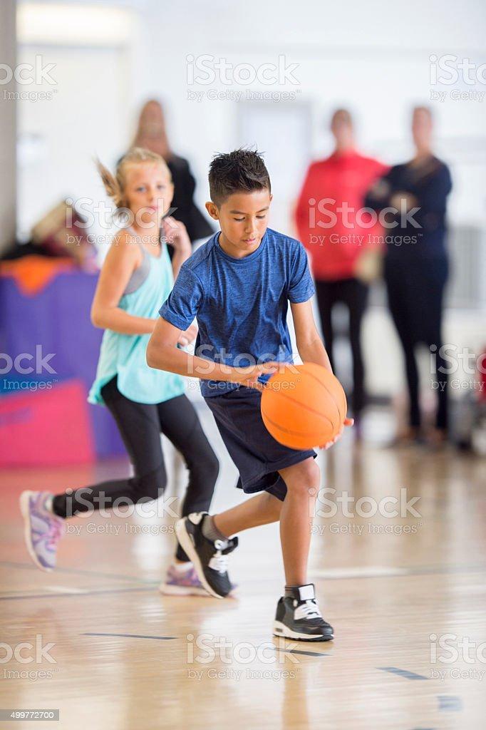 Little Boy Dribbling a Basketball stock photo