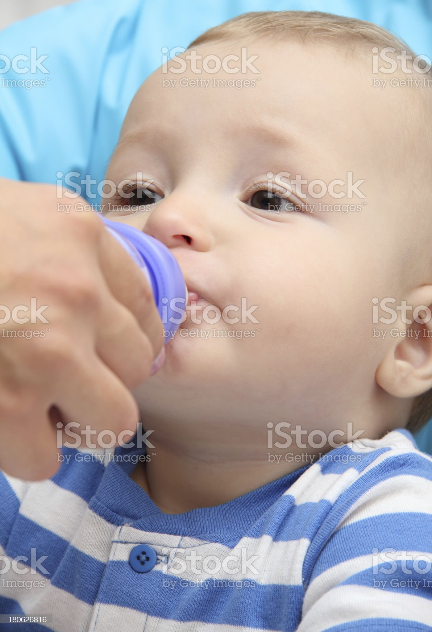 little boy drinks baby milk royalty-free stock photo