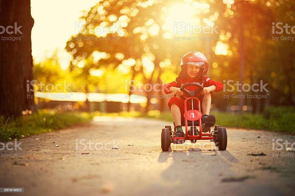 Little boy driving a go-kart stock photo