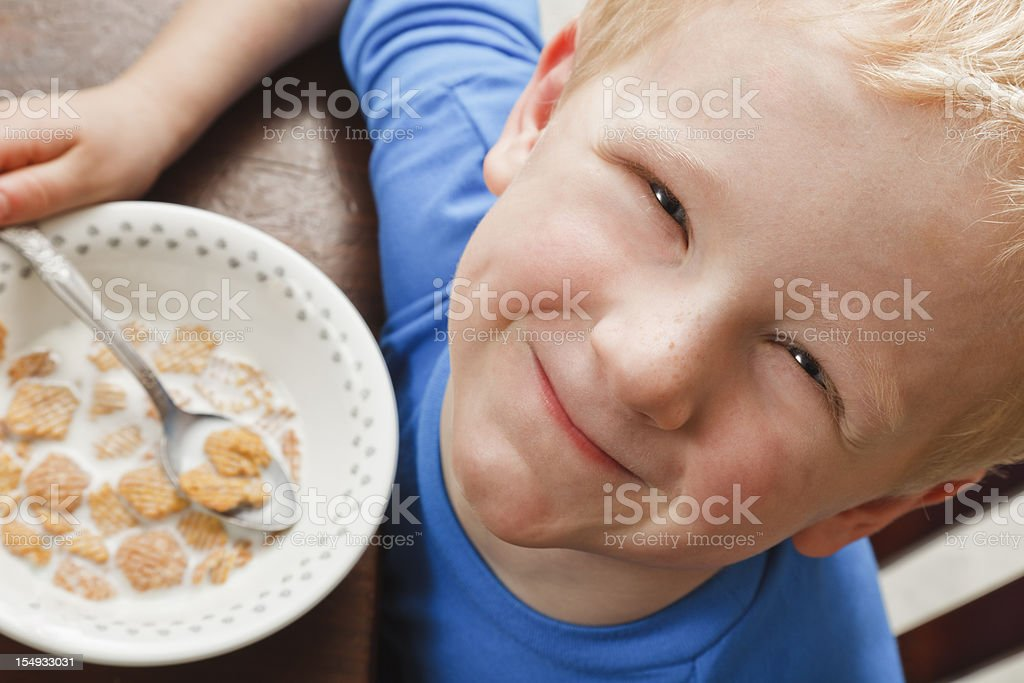 little boy eating breakfast cereal royalty-free stock photo