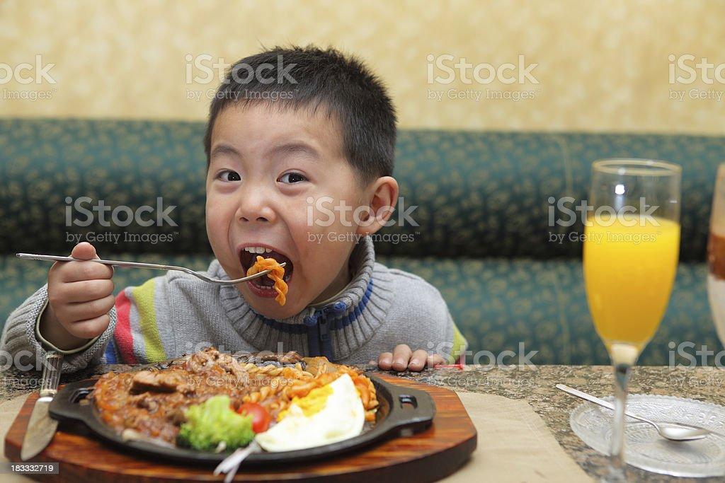 Little boy eating Christmas dinner royalty-free stock photo