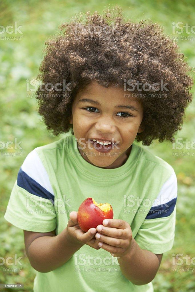 Little Boy Eating Nectarine Outdoors royalty-free stock photo