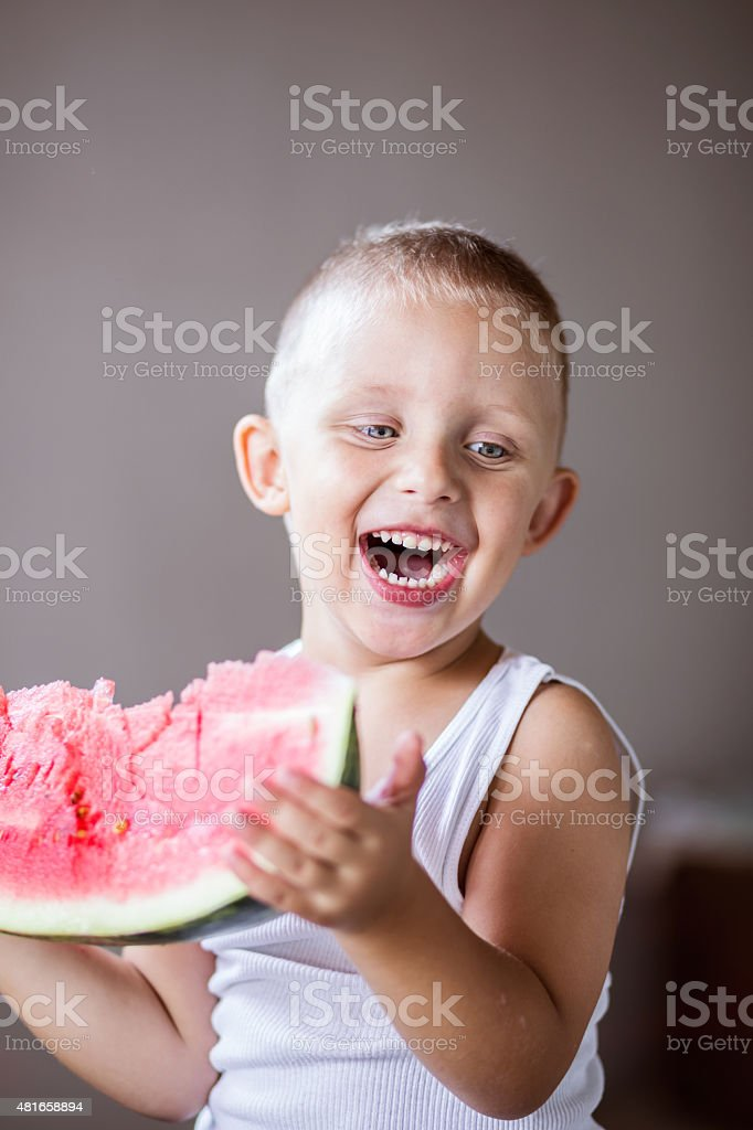 Little boy eating watermelon stock photo