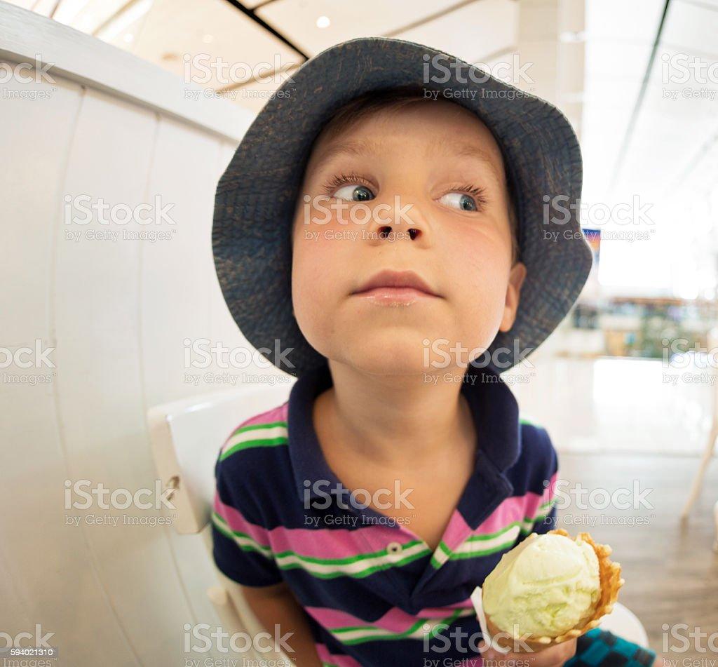 little boy eats ice-cream stock photo