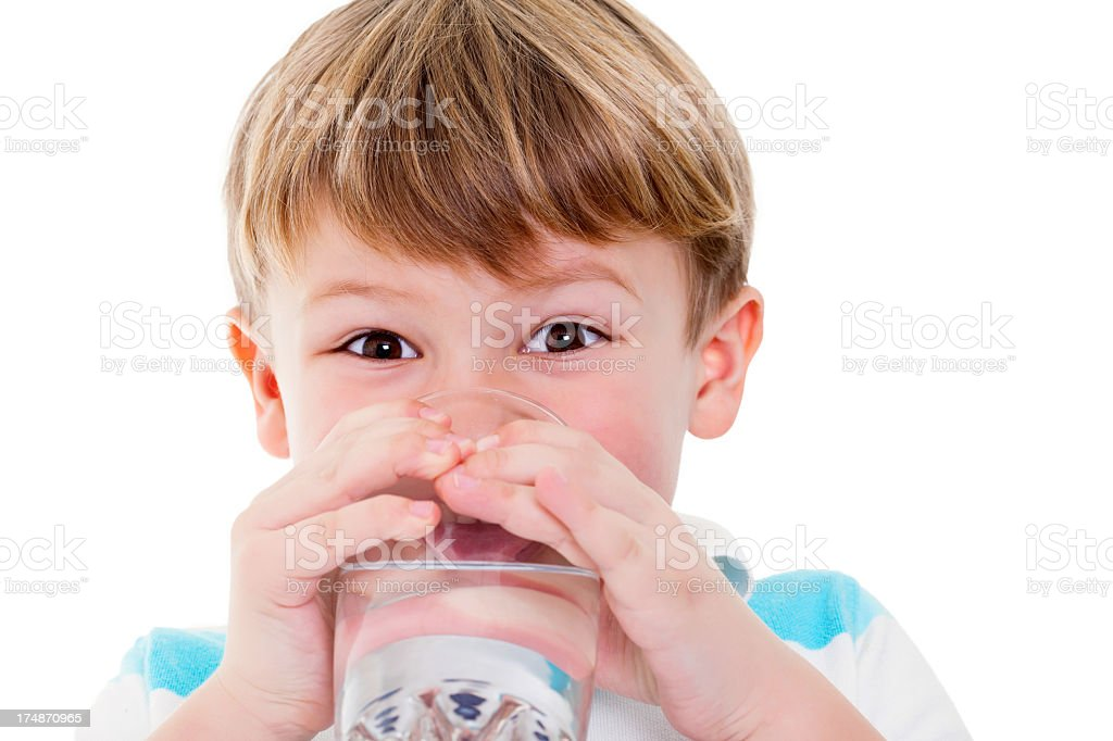 Little boy enjoying a glass of water royalty-free stock photo