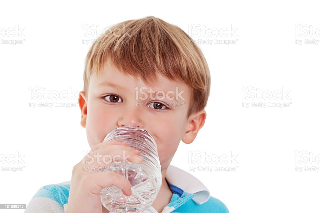 Little boy enjoying a glass of water royalty-free stock photo