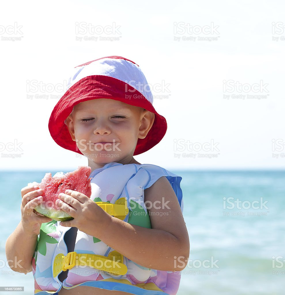 Little boy enjoying some watermelon royalty-free stock photo